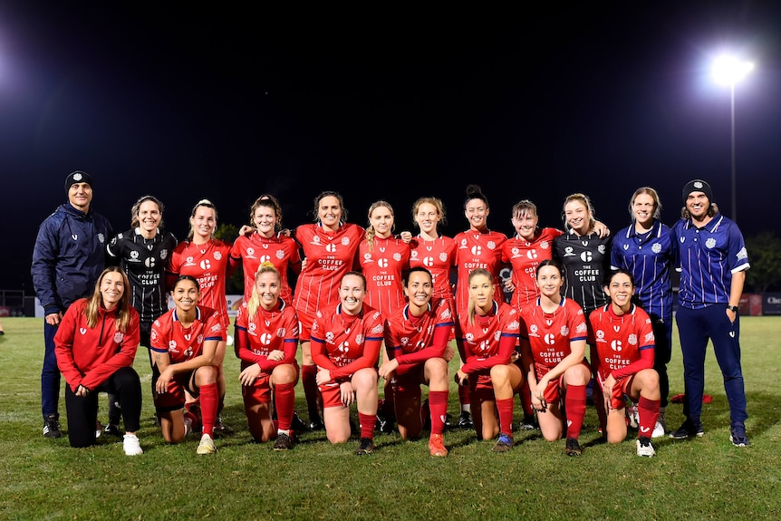 A group photo fo Olympic FC's women's team in their NAIDOC kit.
