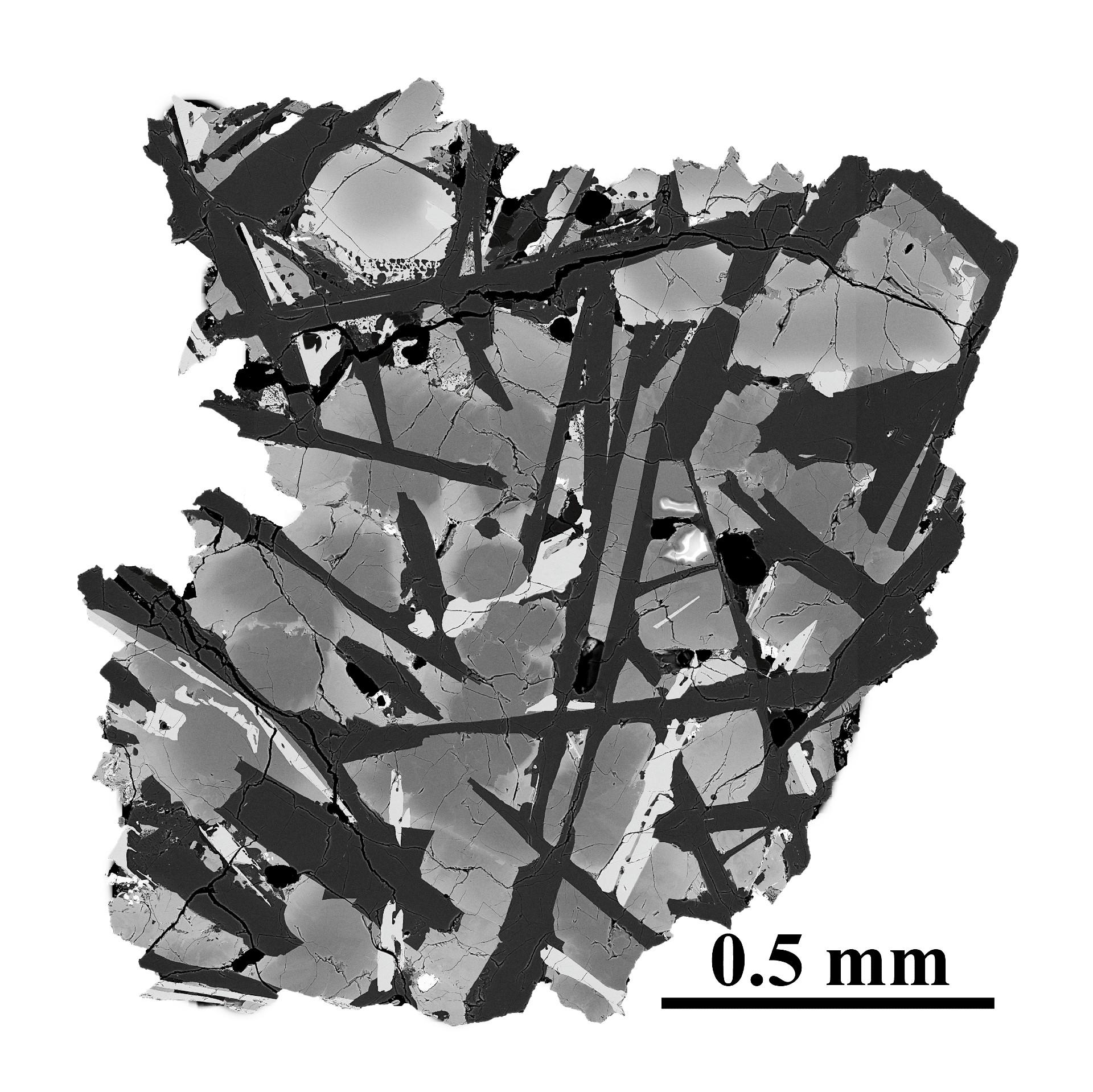 Close-up of grey rock with dark grey striations
