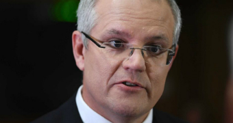 Scott Morrison looks at the camera while talking.