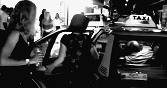 A black and white archival photo of women getting into a taxi in Claremont