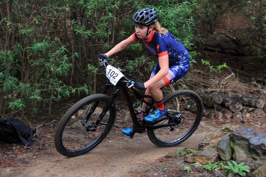 Briony Mattocks rides on Derby Blue track