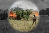 A soldier walks away from a fire in regional Afghanistan