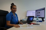 Telstra call centre team leader Thecla Brogan at her desk.