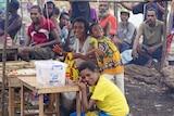 Local people gather on Daru Island.