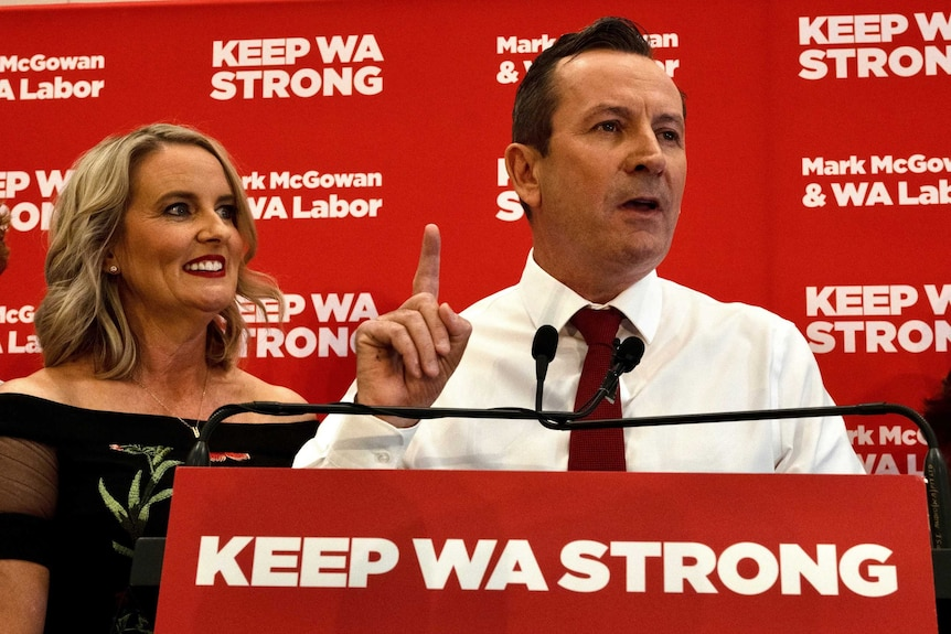 Mark McGowan makes a number one sign during victory speech while standing next to his wife.