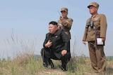 Kim Jong-un guides a rocket-launch, 2014.