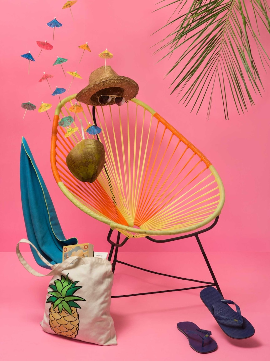 Relaxing summer scene with chair, hat, sunglasses, etc, depicting the importance of rest and recuperation on mental health days.