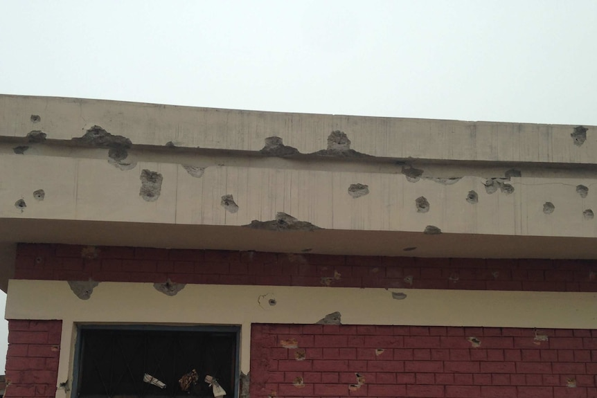 A bullet-riddled wall of the university's hostel.
