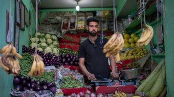 Man at fruit shop in Leh
