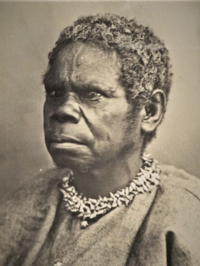 Sepia photograph of Aboriginal woman wearing shell necklace.