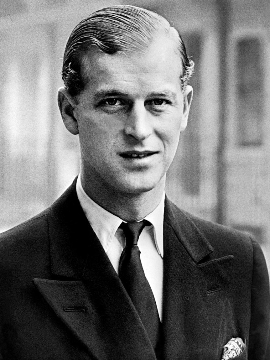 A black and white photograph of Prince Philip dressed in a suit in 1940.