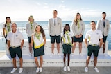 A group of Australian athletes stand wearing the uniform designed for wear at the Olympics opening ceremony in Tokyo.
