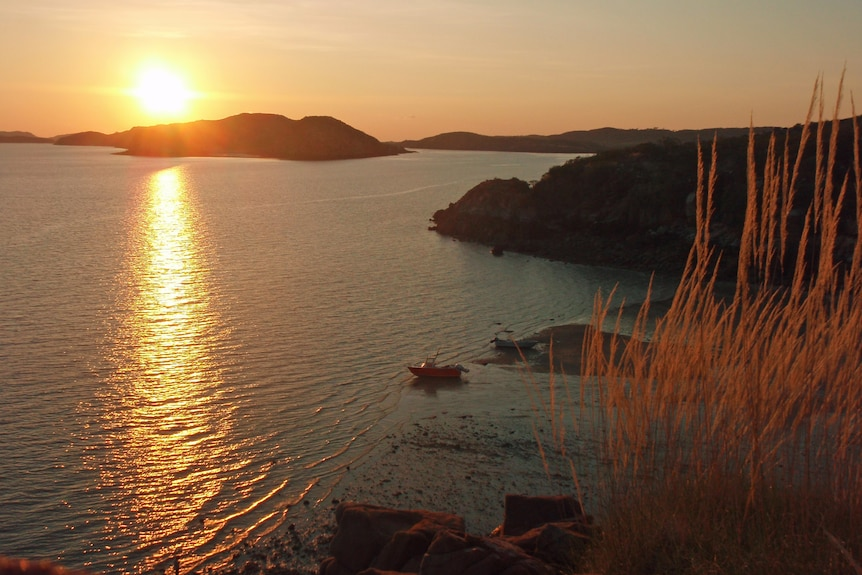 Sunset over a bay and islands.