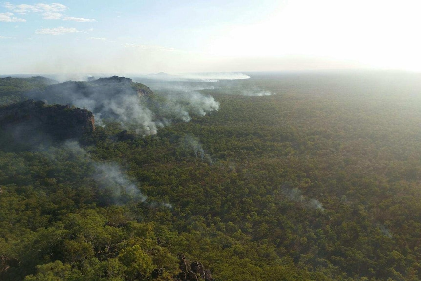 Smoke rises from a remote escarpment in Kakadu National Park, lit by incendiary devices dropped from helicopters.