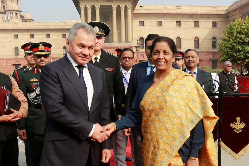 Russian Defence Minister Sergei Shoigu shakes hands with Indian Defence Minister Nirmala Sitharaman