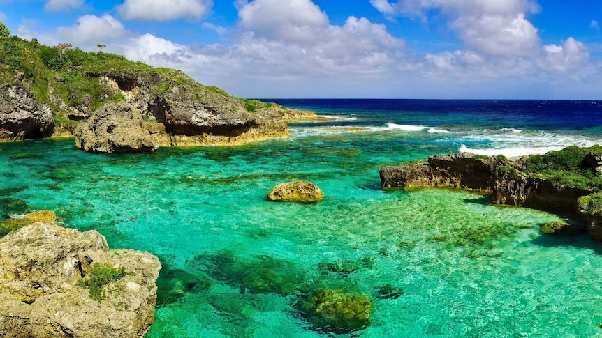 Clear water rock pools along the coast line of Niue