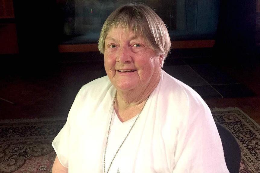 Margaret Warby smiling.