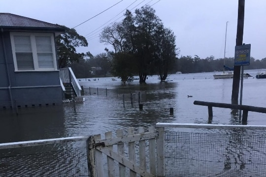 Water laps at a house