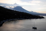 The sun sets behind Mount Agung in Bali.