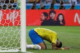 Neymar puts his head to the ground after missing scoring chance