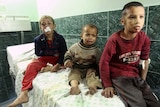 Palestinian boys wounded by an Israeli tank shell wait for treatment at Shifa hospital in Gaza.