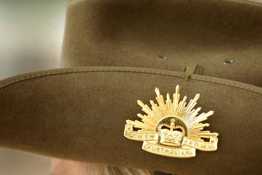 A Rising Sun badge sits on the side of a slouch hat