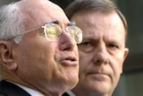 John Howard says Peter Costello will probably be PM during the next term if the Coalition wins the election (File photo).