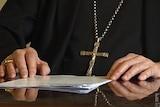Catholic priest argues against crime report law