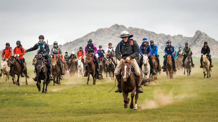 Riders on horseback in the 2016 Mongol Derby