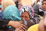 A group of women from Tawergha hug and cry