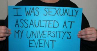 A women holds a placard