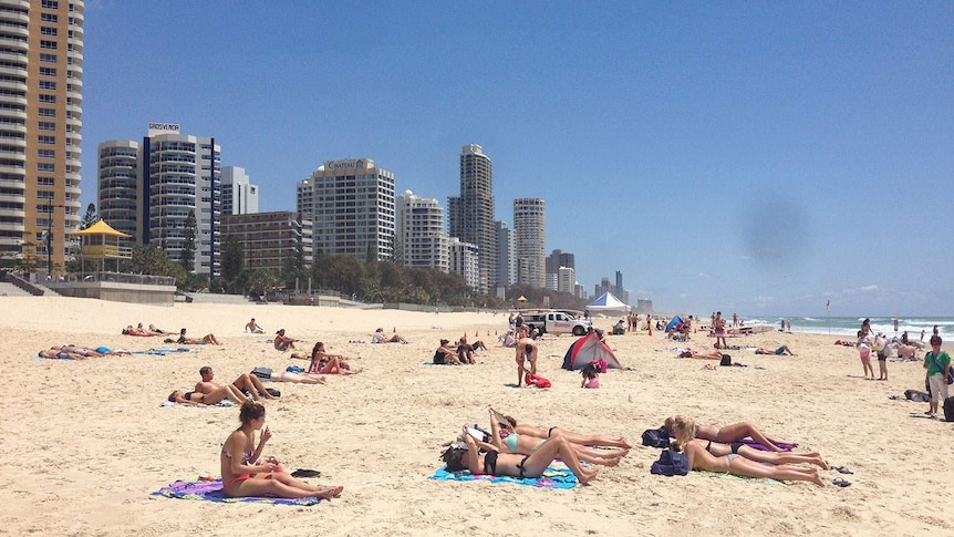 Tourists on the beach at Surfers Paradise.