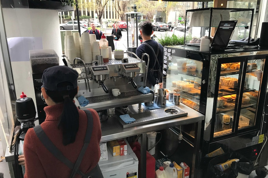 A view behind the coffee machine of a Melbourne cafe.