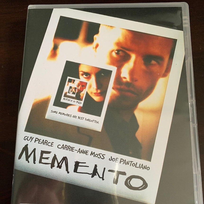 A DVD cover showing polaroid photos and the film title, Memento