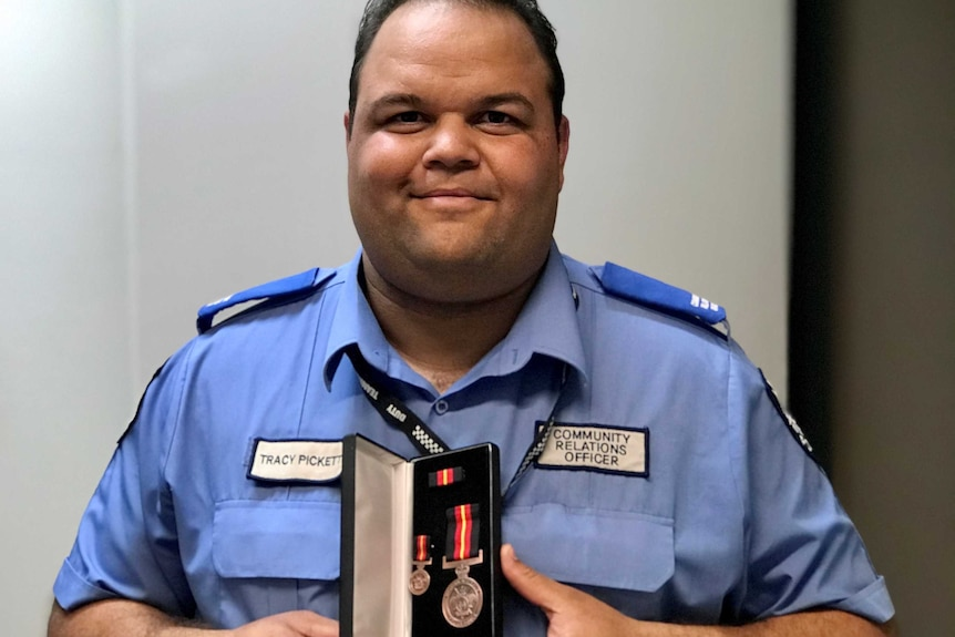 An Indigenous police officer in uniform