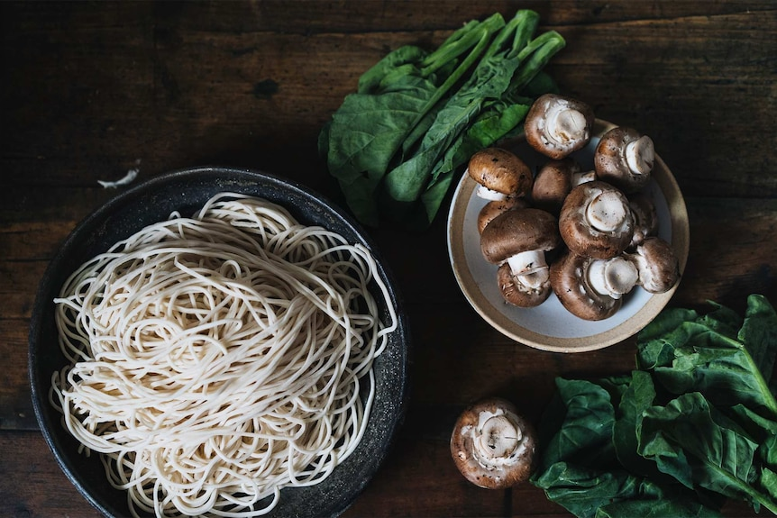 Ingredients for vegan dan dan noodles including fresh noodles, swiss brown mushrooms and Chinese broccoli, for Lunar New Year.
