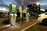 An electric vehicle charging station at dusk in Adelaide