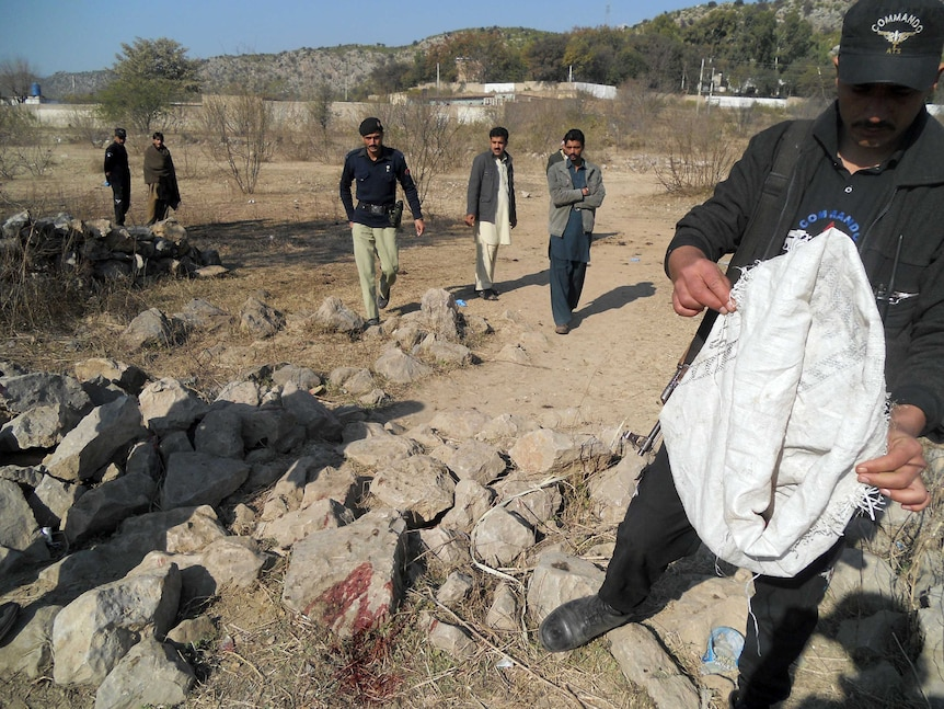 Pakistani security personnel examine the site of a suicide bombing in the Ibrahimzai area of Hangu district.