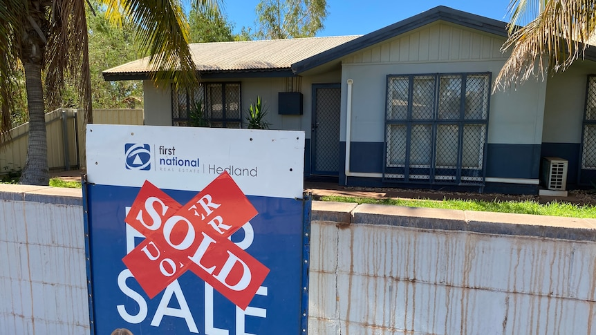 A for sale sign with a sold sticker on it outside a house in South Hedland.