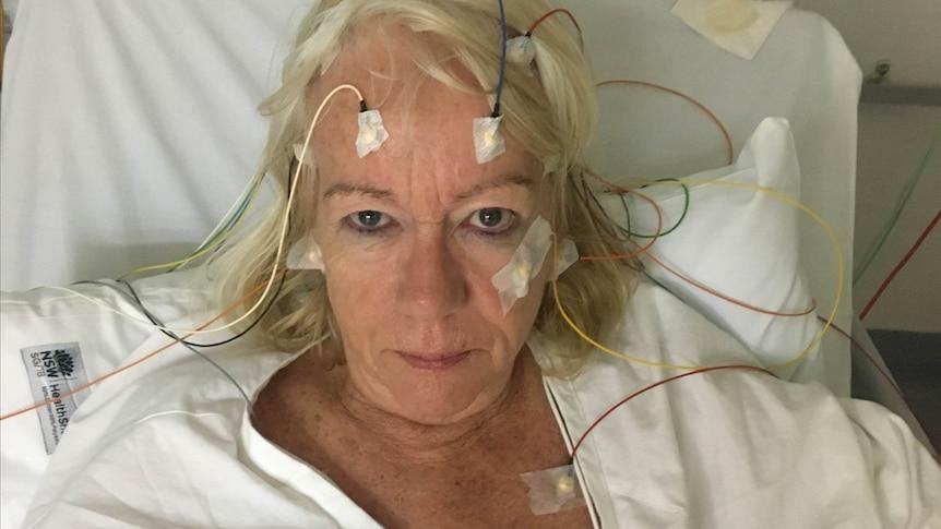 Woman receiving an electroencephalogram in hospital.