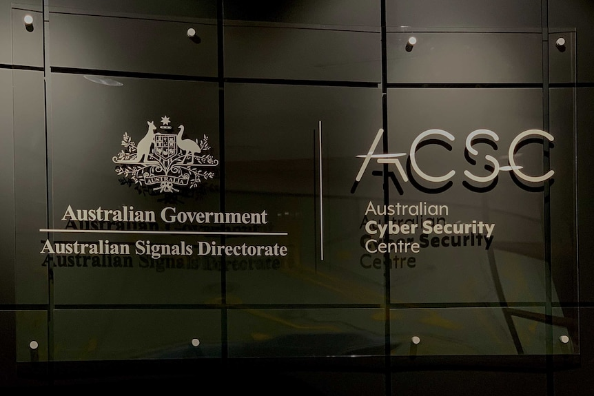A sign against a grey wall stating the Australian Cyber Security Centre and the Australian Signals Directorate.