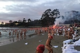 Swimmers exit the water after Dark Mofo's 2017 winter solstice nude swim.