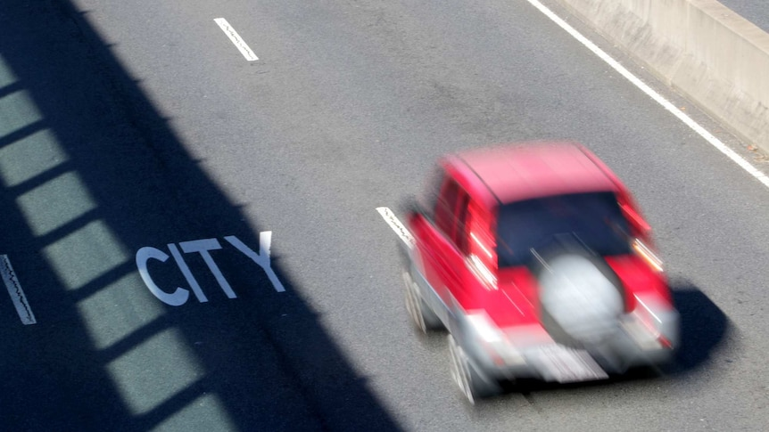 The blur of a car driving along, giving the impression of speed.