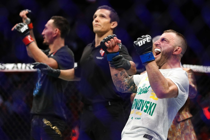 Alexander Volkanovski leans back and screams, with his fists clenched