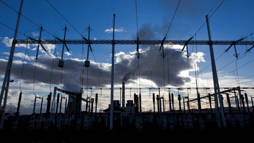 Clouds form behind a power station in Kosovo.