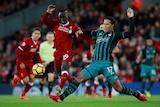 Liverpool's Sadio Mane duels with Southampton's Virgil van Dijk at Anfield on November 18, 2017.