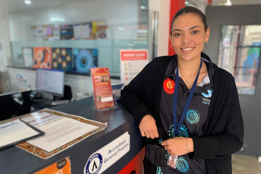 A young Aboriginal woman in a medical setting.