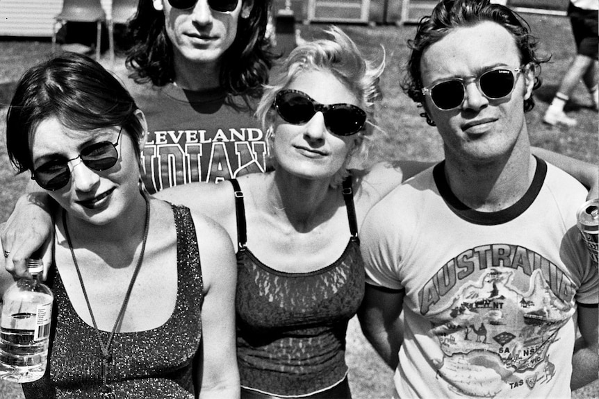 A black-and-white photo of four people posing for a photo at the 1992 Big Day Out.