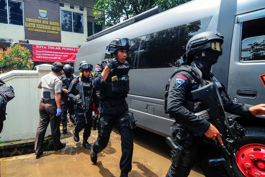 One of the assailants fled to a nearby government office, where police are seen responding.