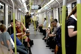 People sitting inside a carriage.